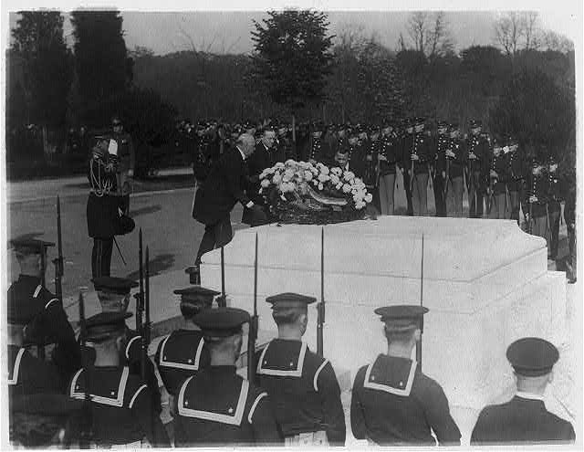 Laying a wreath at the Tomb of the Unknowns on Armistice Day, 1923. November 11 was renamed Veterans Day in 1954.